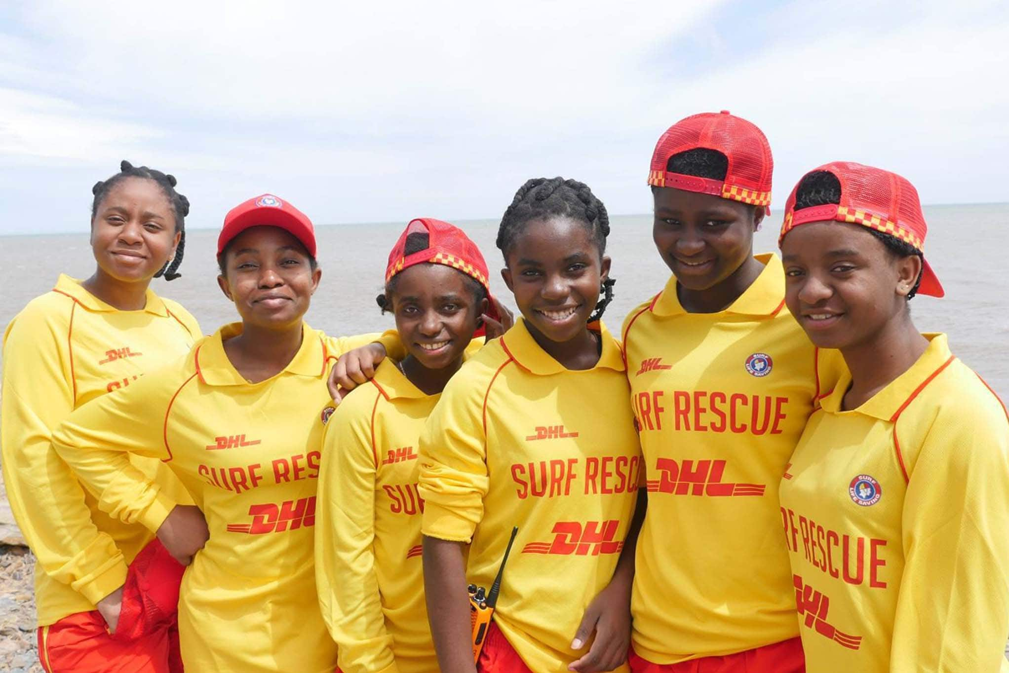 Image of a group of young girls in surf life saving uniforms at the beach.