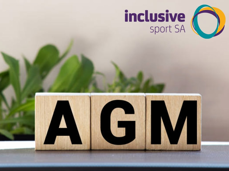 Blocks sit on a table and spell AGM. There is a plant in the background and the Inclusive Sport SA logo appears in the top right hand corner.